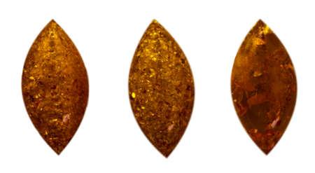 Natural three cabochons of glossy manmade amber close up 스톡 콘텐츠 - 129106304