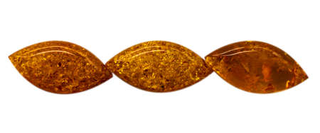 Natural three cabochons of glossy manmade amber close up