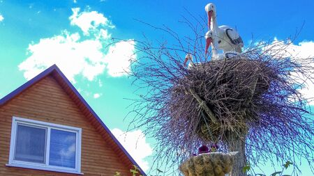 decorative storks in the nest
