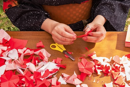 Japanese woman shows a master class on creating origami flowers japanese woman shows a master class on creating origami flowers from paper stock photo 101974893 mightylinksfo