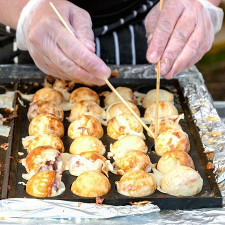 Process to Cooking Takoyaki on hot pan Famous food Osaka Japan street food.