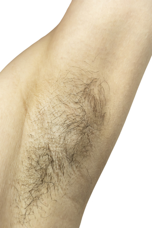 Female unshaved armpit. Isolated on white background. Stock Photo