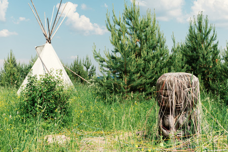 Ancient deity of earth and fertility of the Pachamama in the backdrop of the Indian wigwam