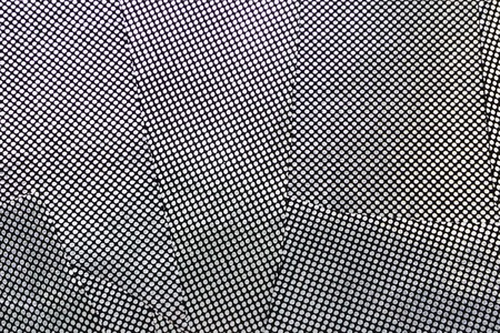 Background of pieces of silver fabric. Silver polka dot fabric