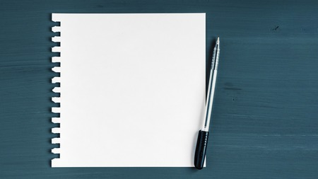 Blank sheet of paper on wooden background.