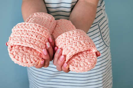 Knitted Slippers handmade in women's hands. Manual work Stockfoto