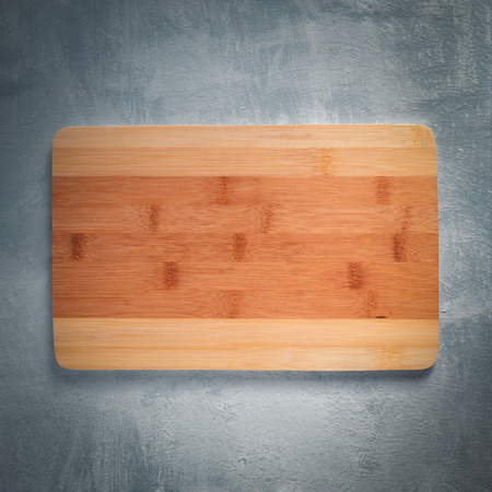 Bamboo cutting Board on grey background. Top view