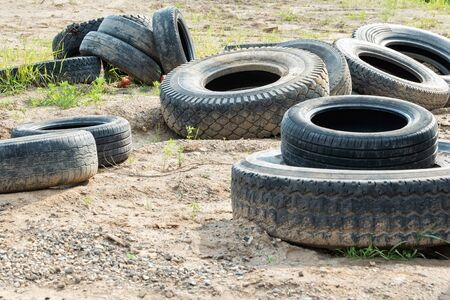 Dump of old car tires. Used car tires 写真素材