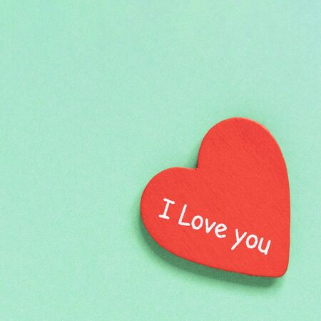 Red heart with text I love you on a light blue background