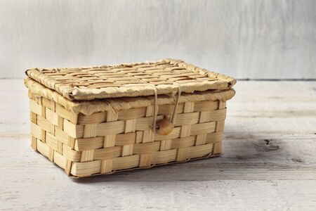 Wicker wooden box on a white background