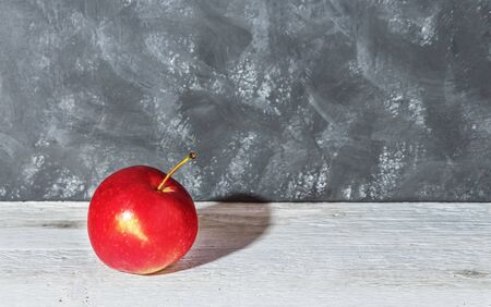 One red Apple on a gray wooden background 写真素材