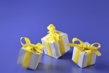 Gift boxes with a yellow bow on a blue background