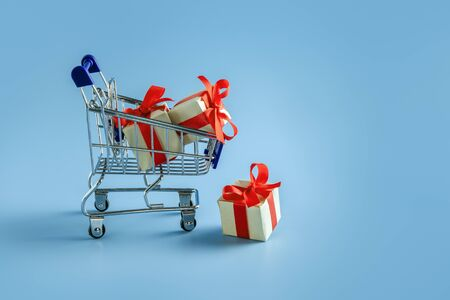 Shopping cart with gifts. Gift boxes in a supermarket cart