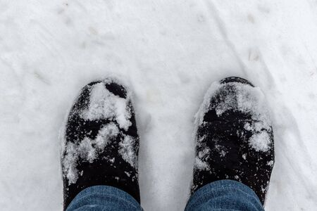 Winter suede boots. Boots on white snow