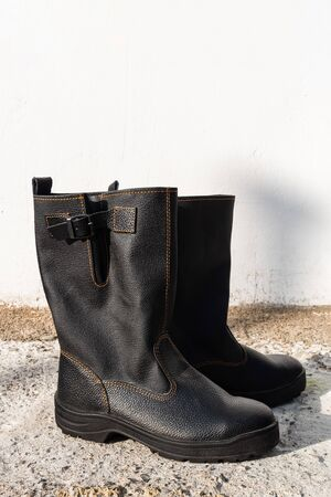 New black polished male high boots. Vertical image
