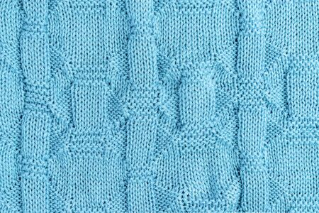 Knitted light blue background. Knit needles pattern 写真素材