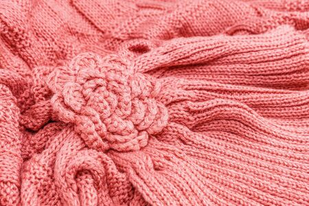 Knitted pink flower close up. Knitted ornament