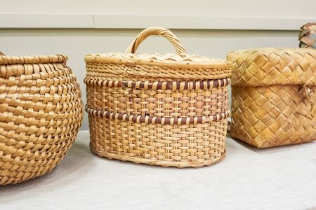 Retro wicker basket closed with a lid. Rustic style 写真素材