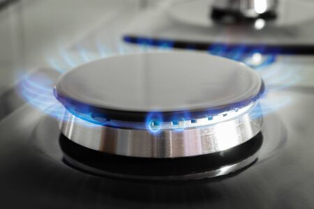 Gas stove burner with open fire close up