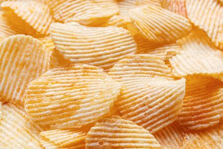 Chips background. Potato chips corrugated close up