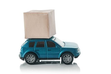 Concept of a transport delivery service. Car with a box on the roof, isolated on a white background