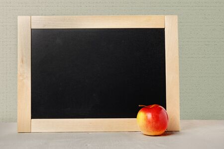 School board with empty space for text. The background school board and the apple