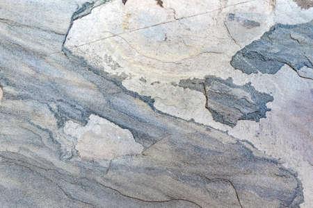 Textured stone wall with a pattern. Gray rock wall background. Zdjęcie Seryjne