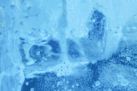 Texture Blue Ice. Frozen ice wall background.
