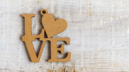 Wooden heart and text I love you on an old white background. Valentine day 免版税图像