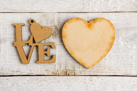 Wooden Heart and the text I love you on a white background. Vintage style