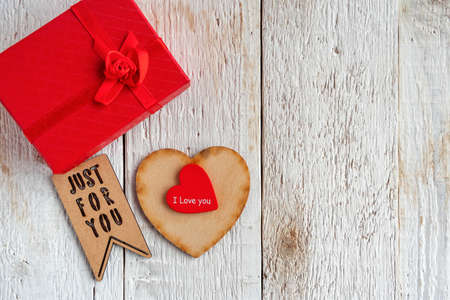 Red and wooden hearts, gift box and text just for you. Declaration of love