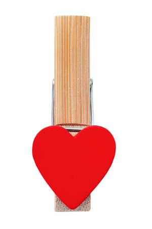 Clothespin linen with red heart isolated on white background.
