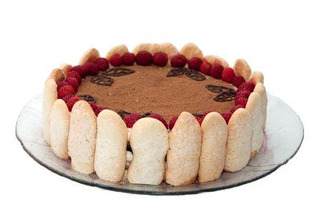 Delicious Italian dessert tiramisu decorated with raspberries isolated on white photo