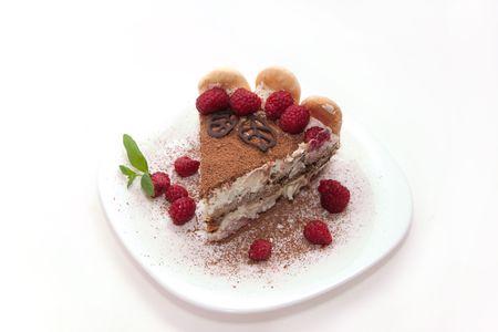 Delicious Italian dessert tiramisu decorated with raspberries photo