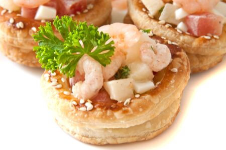 Volauvents filled with fresh shrimp salad isolated on white photo