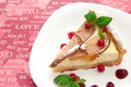 Homemade pie with fresh pears and cottage cheese and red currants on pink paper with text photo