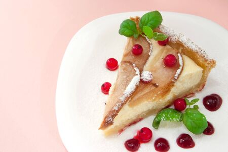 Homemade pie with fresh pears and cottage cheese and red currants on pink photo
