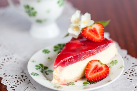 desserts: Strawberry cheesecake decorated with jasmine and a half of strawberry