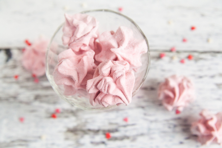 pastila: Handmade sweet pink zephyr marshmallowin a glass bowl. Heart small candies. Valentines day