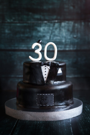 White and black tuxedo wedding or mans birthday cake with white number 30