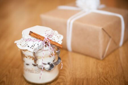 glass jars: Dry mixing ingredients for chocolate chip cookies in a glass jar handmade gift
