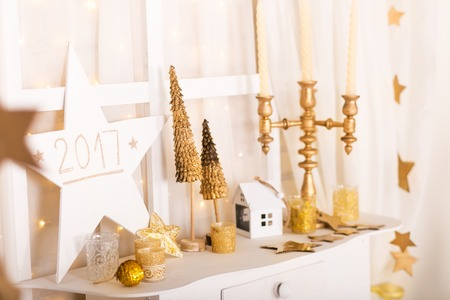 Christmas gold and white decorations. Christmas time