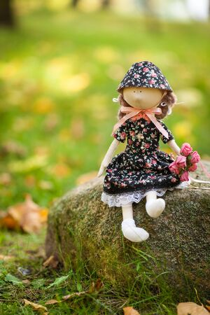 A doll on the stone Stock Photo