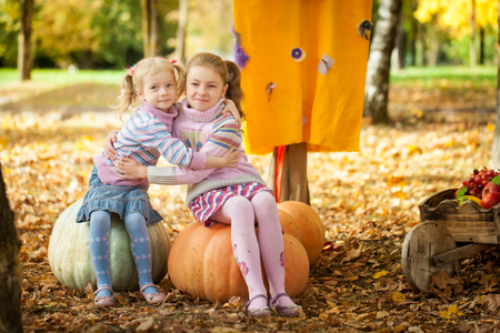 Two sisters in the autumn park