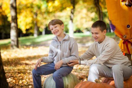 family tickle: Boys in the autumn park
