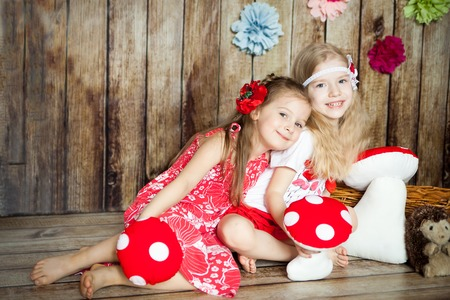 Pretty girls in an easter decorated studio with wooden background