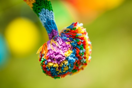 Rainbow pompom. Vibrant decor for birthday or wedding summer party Stock Photo