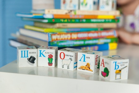 Back to school details: cubes with letters, text SCHOOL in russian language. Many books