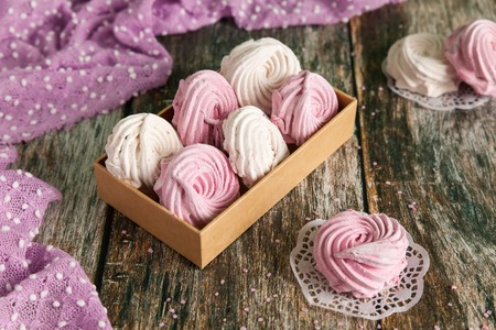 Fresh homemade berry zephir marshmallow in a box on wooden background. Sweet zephyr for holiday Stock Photo