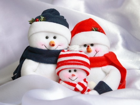 snowman: Christmas Snowman Family   Happy Snowmen on White Snow Background Stock Photo